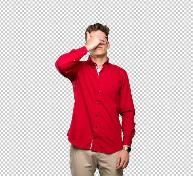 Handsome young man covering eyes by hands Premium Psd