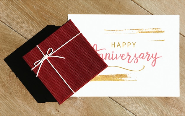 Happy anniversary card mockup with a gift box Free Psd