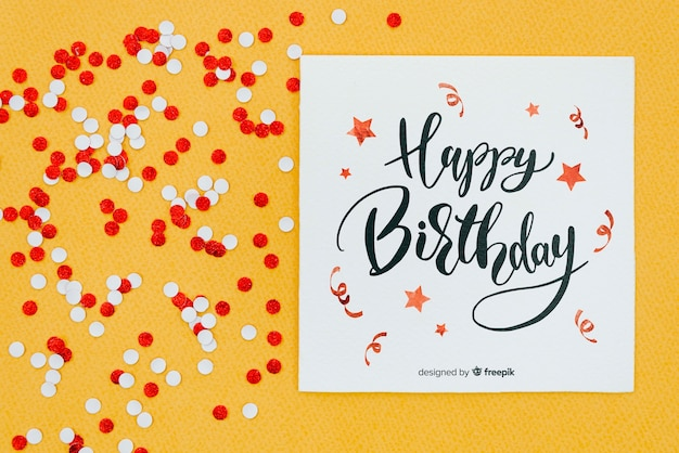 Happy birthday on card with red and white confetti Premium Psd