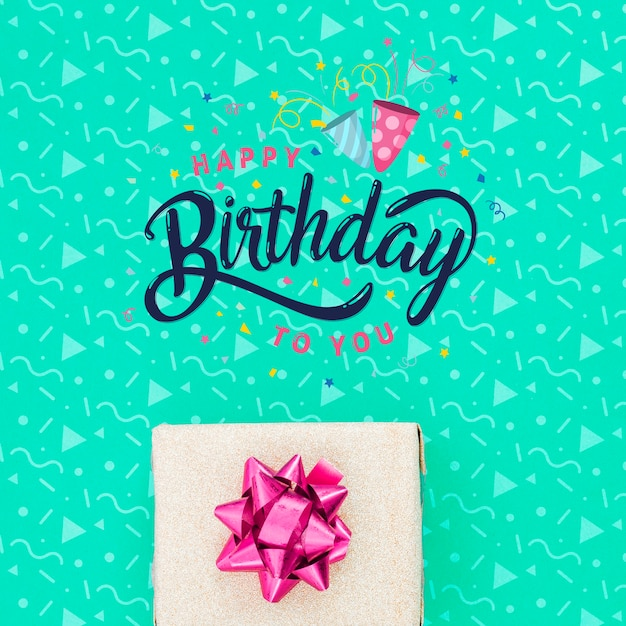Happy birthday message beside gift Free Psd