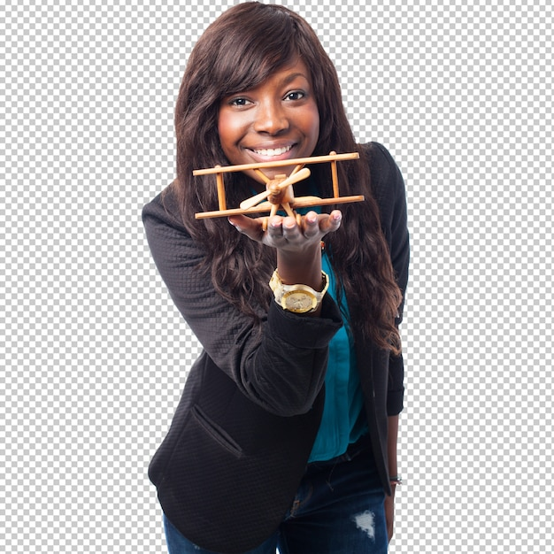 Happy black woman with biplane Premium Psd