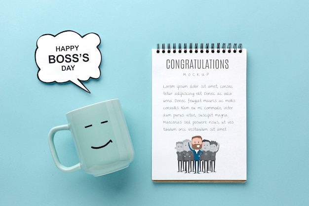 Happy boss's day with mug and notebook Free Psd