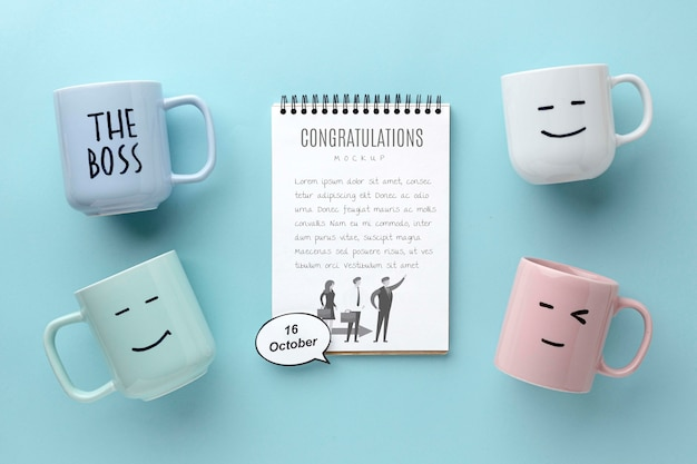 Happy boss's day with notebook and mugs Free Psd