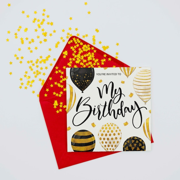 Happy colourful birthday letter and envelope with confetti Free Psd