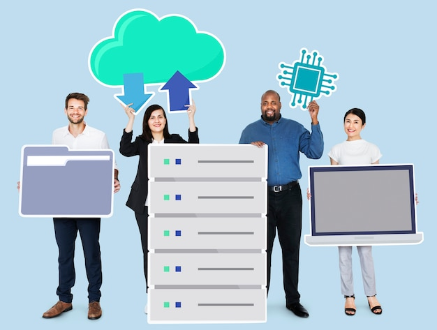 Happy diverse business people holding office technology icons Premium Psd