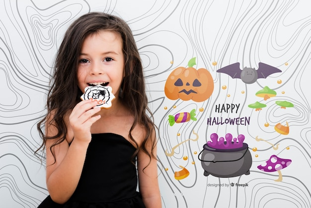 Happy halloween cute girl eating a candy Free Psd