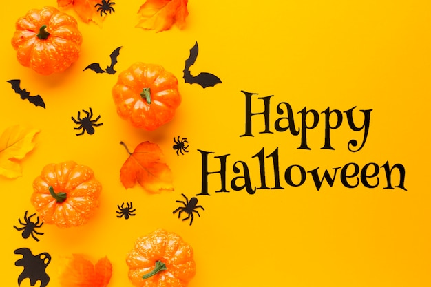 Happy halloween message with pumpkins Free Psd