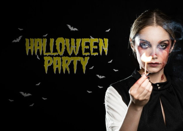 Happy halloween party with make-up girl holding a match Free Psd