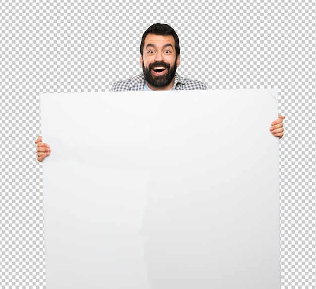 Happy handsome man with beard holding an empty placard Premium Psd