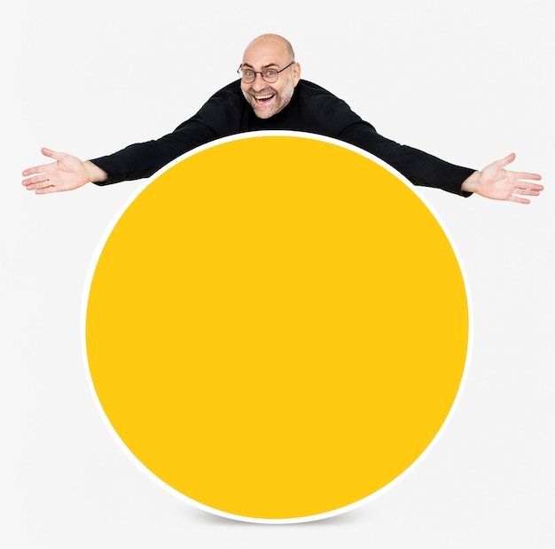 Happy man showing a round yellow board Free Psd