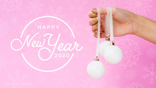 Happy new year 2020 with white christmas ball on pink background Free Psd