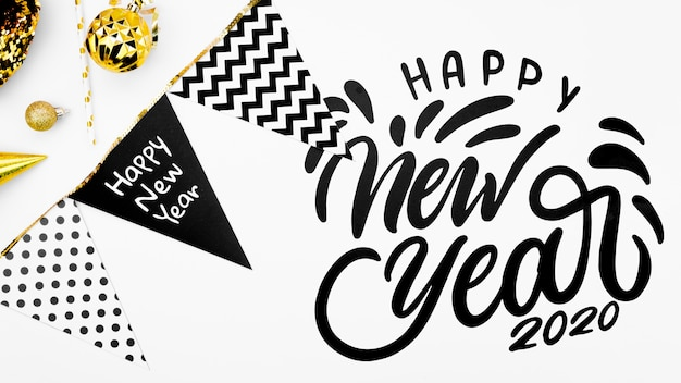 Happy new year lettering with garland Free Psd