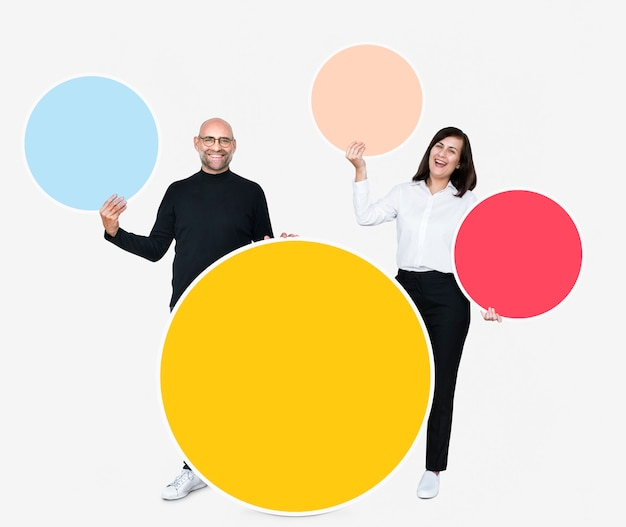 Happy people holding colorful round boards Free Psd