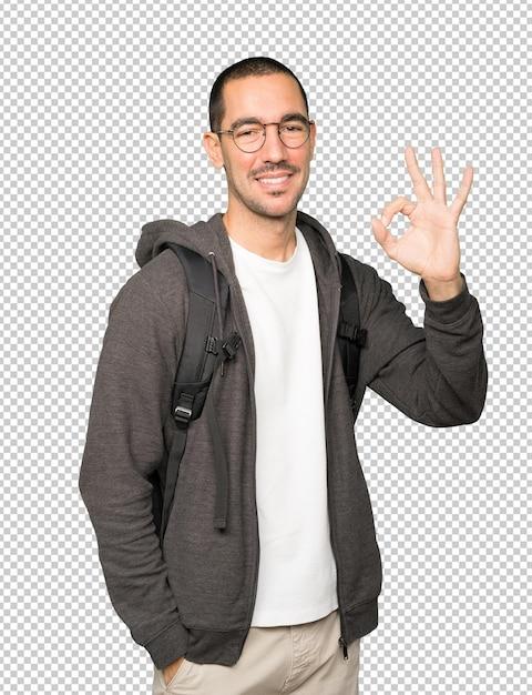 Счастливый студент делает правильный жест Premium Psd
