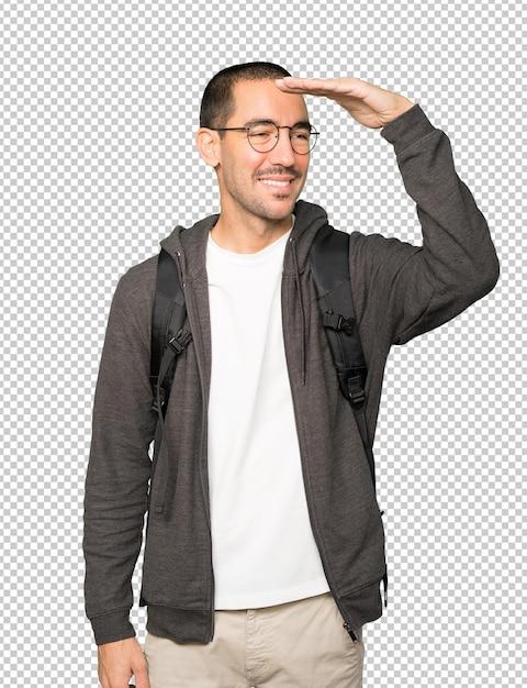Счастливый студент с жестом глядя в сторону Premium Psd