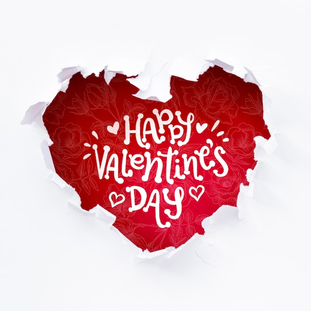 Happy valentines day lettering in red heart shaped hole Free Psd