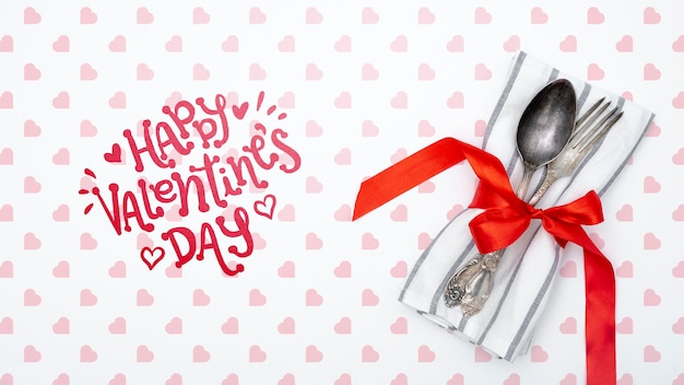 Happy valentines day lettering with tableware Free Psd