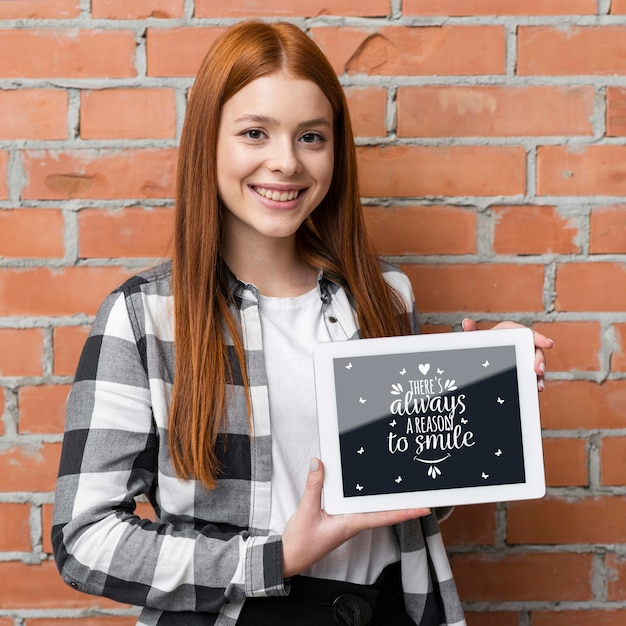 Happy woman holding tablet mock-up Free Psd