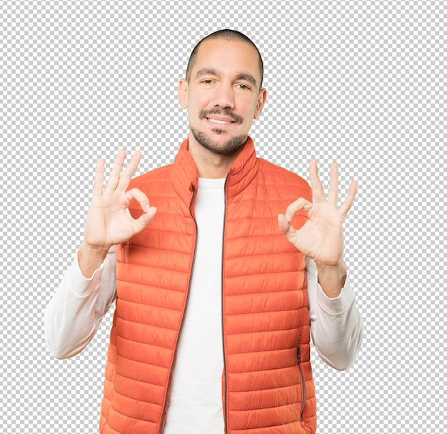 Happy young man doing an all right gesture Premium Psd