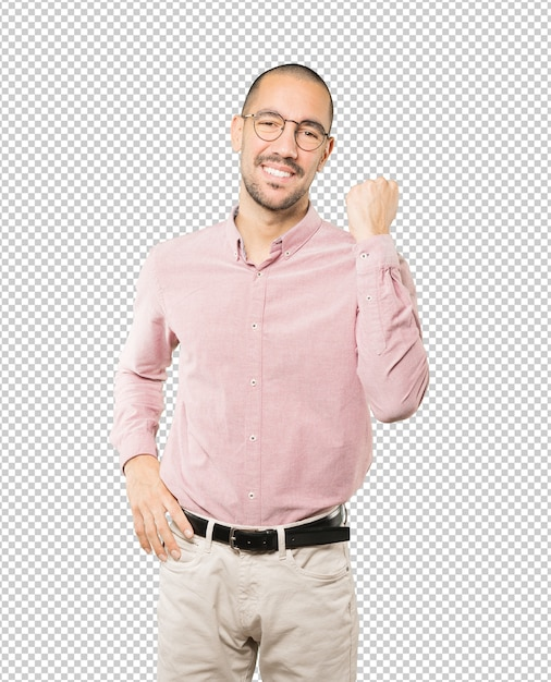 Happy young man doing a competitive gesture Premium Psd