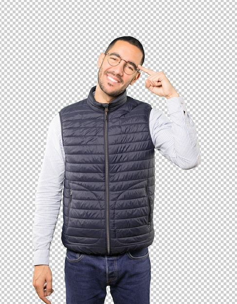 Happy young man doing a gesture of concentration Premium Psd