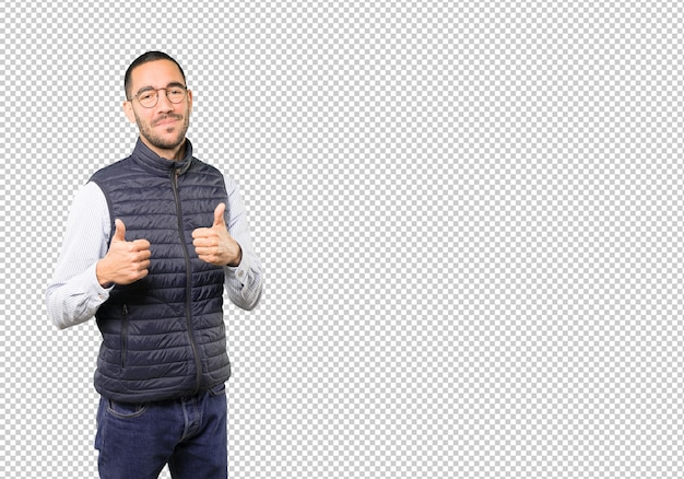 Happy young man gesturing that everything is fine Premium Psd
