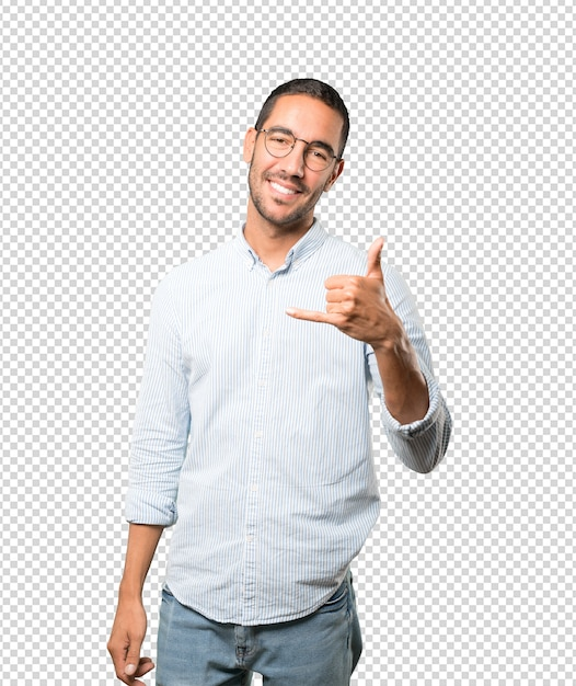 Happy young man making a gesture of calling with the hand Premium Psd