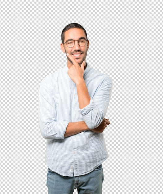 Happy young man making a gesture of doubt Premium Psd