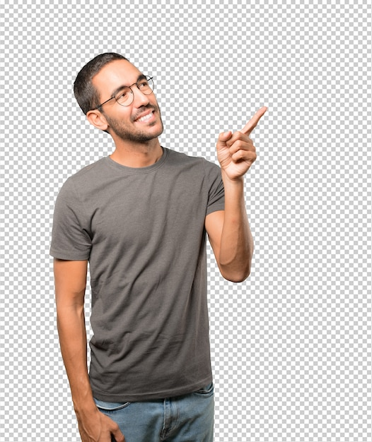 Happy young man pointing up with his finger Premium Psd