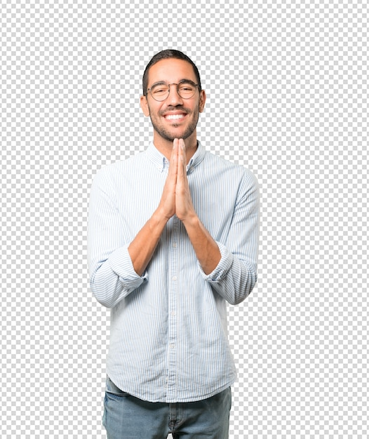 Happy young man praying gesture Premium Psd