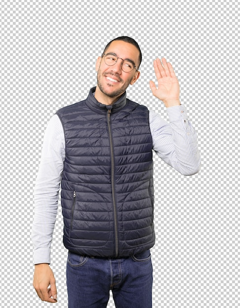 Happy young man smiling and making a gesture of trying to hear something Premium Psd
