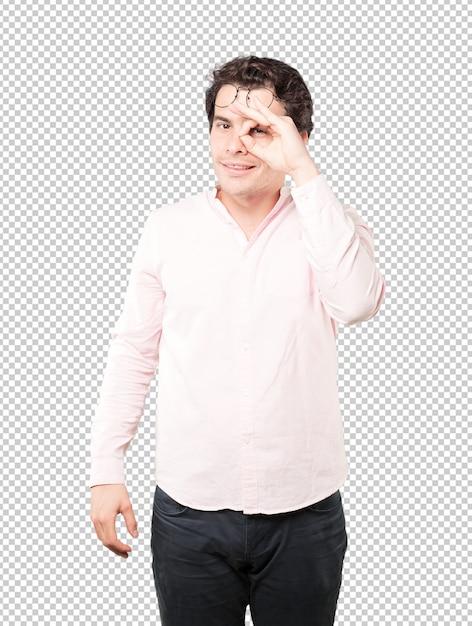 Happy young man using his hands like a binoculars Premium Psd