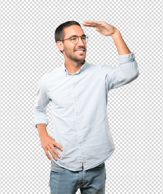 Happy young man with a gesture of looking away Premium Psd