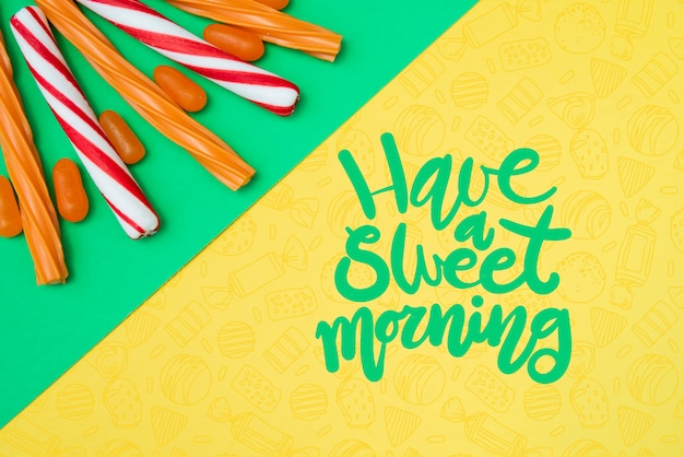 Have a sweet morning with sugar candy sticks Free Psd