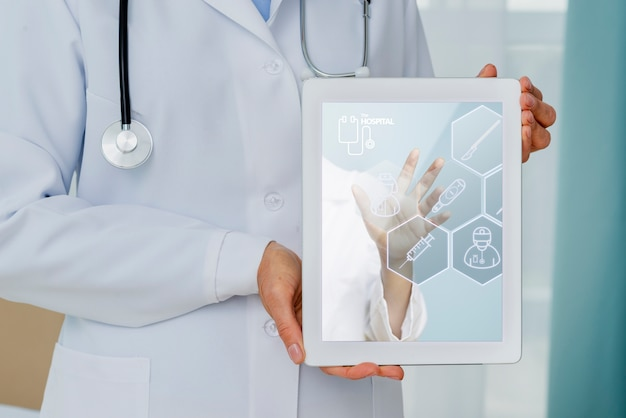 Health tablet held by doctor close-up Free Psd