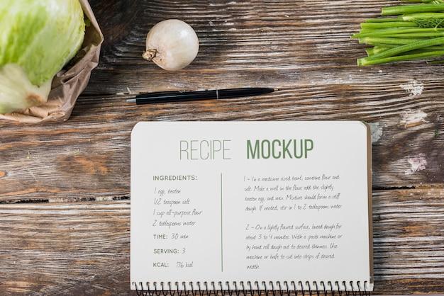 テーブルの上の健康食品のレシピのモックアップ Premium Psd