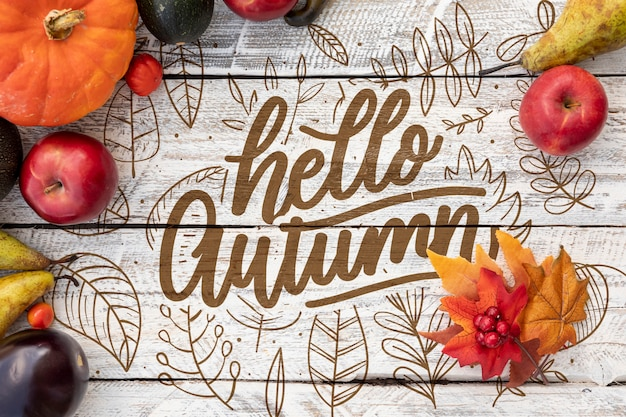 Hello autumn concept with apples and pumpkin Free Psd