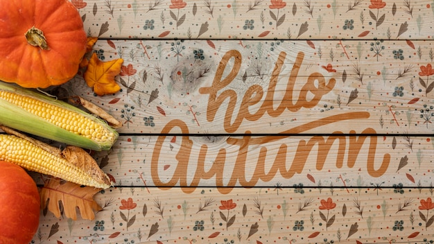 Hello autumn concept with foliage doodles Free Psd