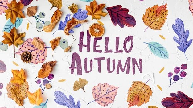 Ciao autunno saluto testo con foglie secche Psd Gratuite