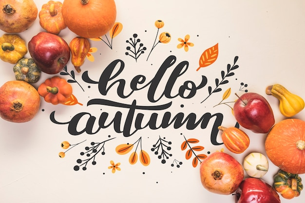 Hello autumn lettering with fall healthy food Free Psd