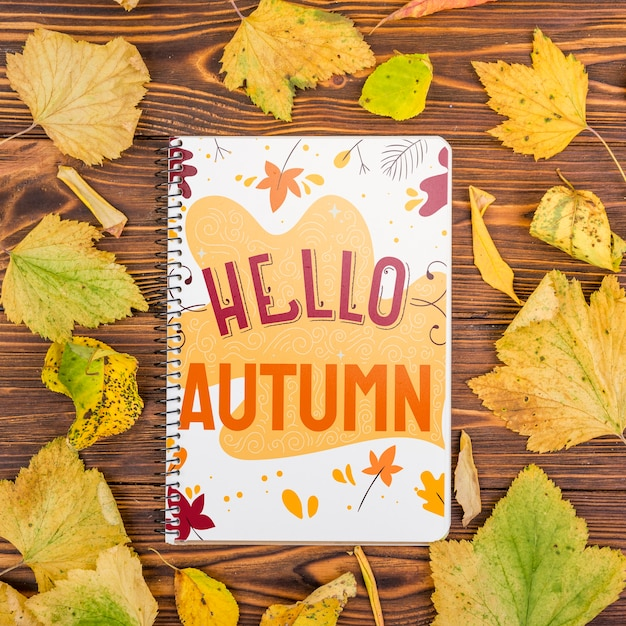 Hello autumn message on notebook with mock-up Free Psd