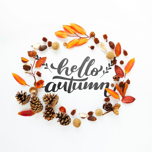 Hello autumn quote in a circle of dried leaves Free Psd