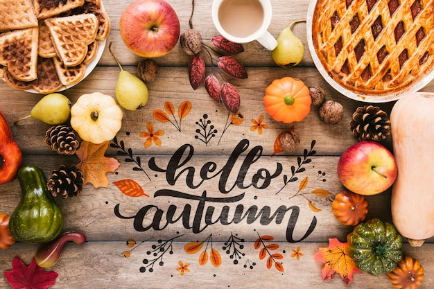 Hello autumn quote surrounded by delicious food Free Psd