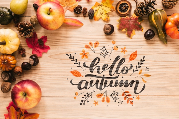 Hello autumn quote with leaves and apples Free Psd