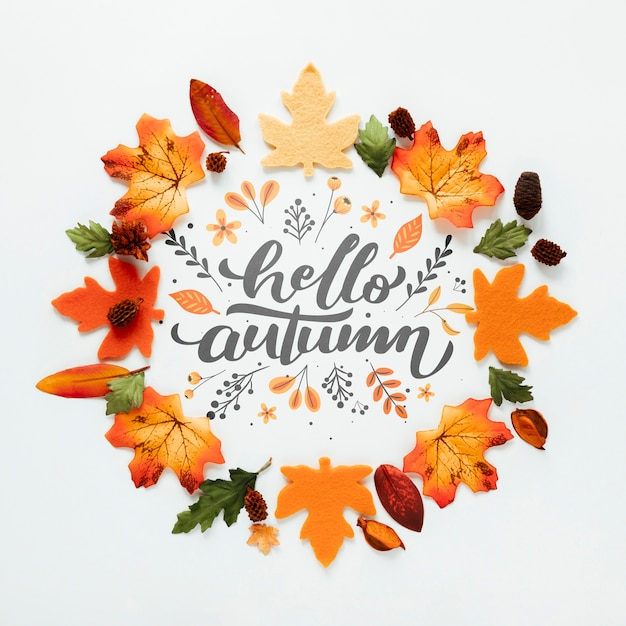 Hello autumn quote with leaves in orange shades Free Psd