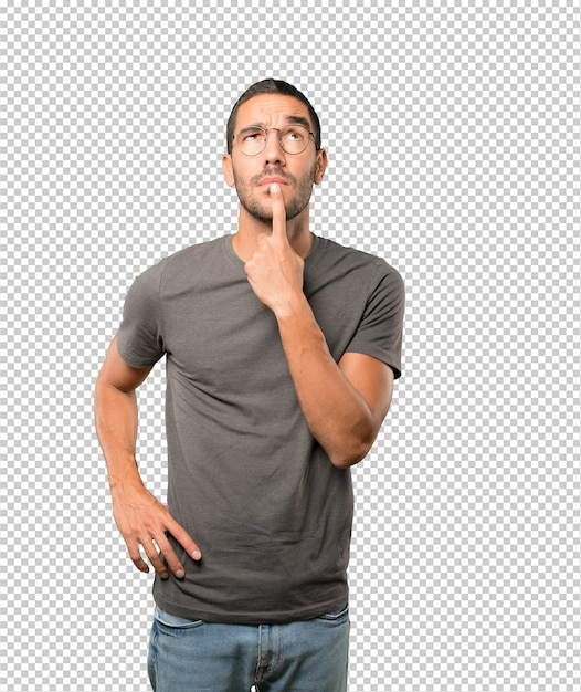 Hesitant young man looking gesture Premium Psd