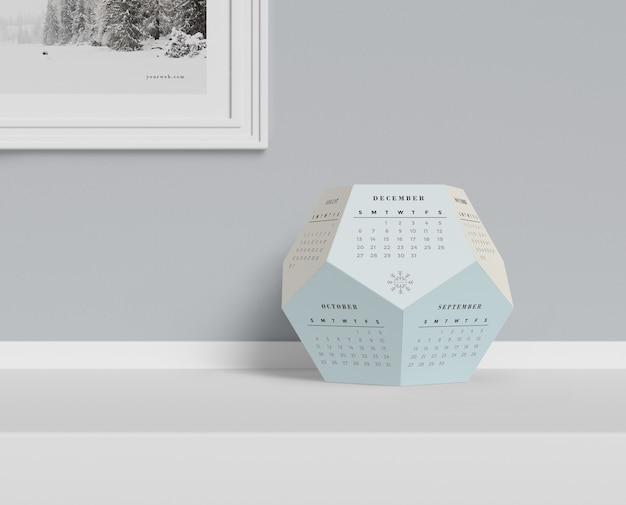 Hexagonal calendar conceput on table Free Psd