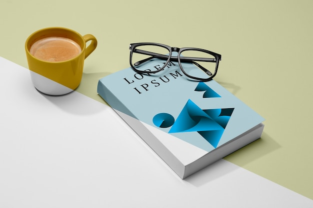 High angle book mock-up with glasses and coffee Free Psd