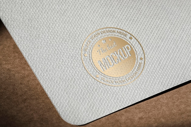 High angle of business paper card mock-up with coarse surface Free Psd