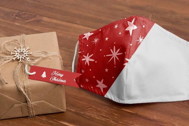 High angle christmas gift and mask Free Psd